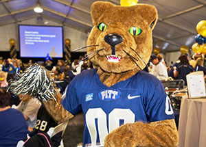 Roc the Panther joined Pitt student athletes and cheerleaders in greeting more than 900 Chancellor's Circle donors and guests who attended the 2013 Chancellor's Circle Celebration event in the big tent at Heinz Field before the Panthers faced off against the University of North Carolina on Nov. 16.