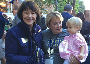 Jane Allred, president of the Pitt Alumni Association, with Winifred Allen-Coleman and her granddaughter.