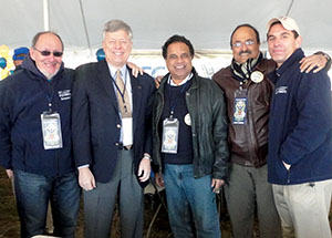 Colleagues in Pitt's Swanson School of Engineering join Chancellor Nordenberg in the pregame-event tent in Annapolis. From left, Distinguished Professor of Bioengineering Harvey Borovetz, Chancellor Nordenberg, Distinguished Professor and Chair of Bioengineering Sanjeev Shroff, Professor of Bioengineering Pratap Khanwilkar, and Matt Weinstein, senior executive director of development and alumni relations.