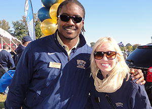 University staff members and alumni Ron Idoko and Molly Knorr enjoy pregame festivities at the Pitt vs. Navy showdown in Annapolis, Md., on Oct. 26.