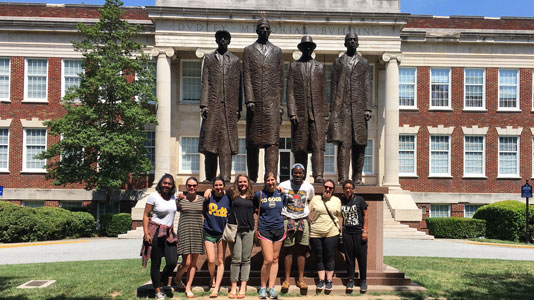 Pitt students at the statue of the Greensboro Four, on the campus of North Carolina A&T State University.