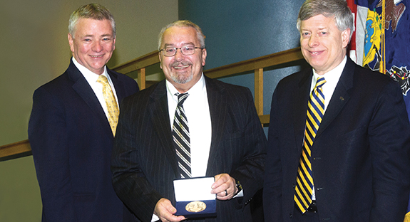 Jerome Cochran received the University's 225th Anniversary Medallion during a Feb. 22, 2013, meeting of Pitt's Board of Trustees. From left, Pitt Board Chair Stephen Tritch, Cochran, and, now Chancellor Emeritus Mark A. Nordenberg.