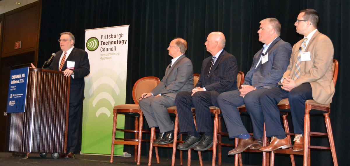 Moderator Matt Butkovic of CERT poses questions to four panelists, (left to right) Fred Hintermister, David J. Hickton, Matt LaVigna and Grant Ervin.