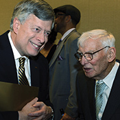 Nordenberg converses with Dan Rooney, chair of the Pittsburgh Steelers.