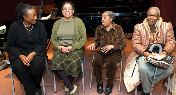 From left, pianist and Pitt Jazz Studies Program Director Geri Allen chats with Mary Lou Williams' relatives Bobbie Ferguson, Geraldine Garnett, and Margaret Burley.