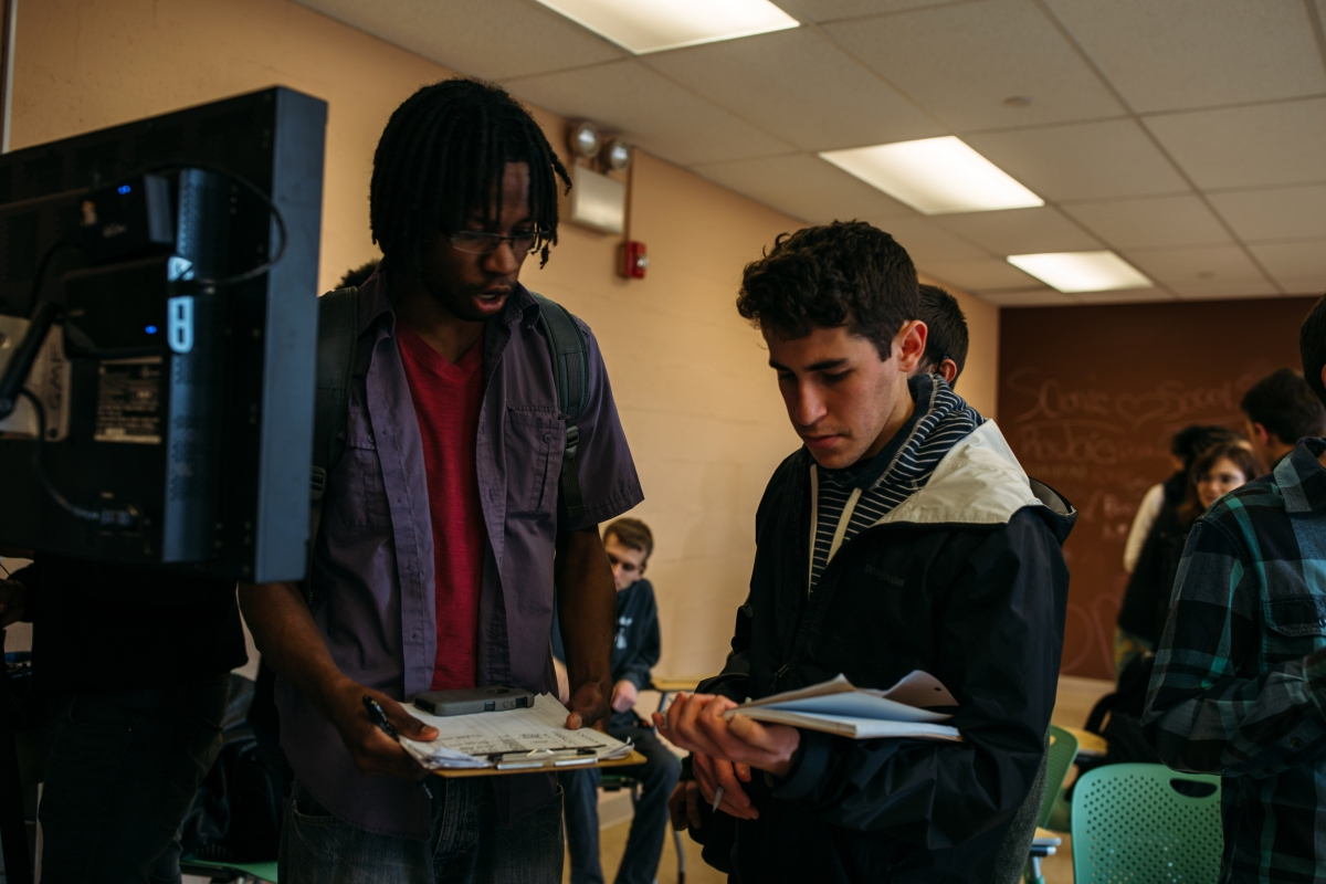 "Ian McIntosh, script supervisor for ""The Rehabilitation of the Hill,"" reviews a scene's shots with Pitt senior Joaquin Gonzalez. Gonzalez studies mechanical engineering in the Swanson School of Engineering."
