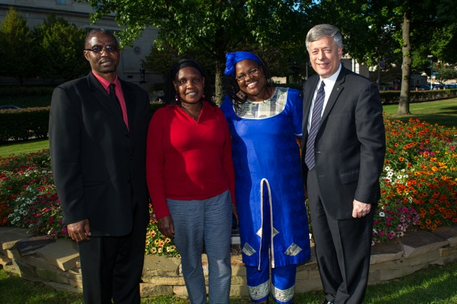 Pitt faculty hailing from Kenya joined Chancellor Mark A. Nordenberg at the dedication of the Wangari Maathai Trees and Garden. From left, Julius Kitutu, assistant dean for student services and assistant professor of acute and tertiary care in the School of Nursing; Macrina C. Lelei, associate director of the African Studies Program and adjunct assistant professor of administrative and policy studies in the School of Education; Leonora Kivuva, Swahili instructor in the Department of Linguistics; and Chancellor Nordenberg.