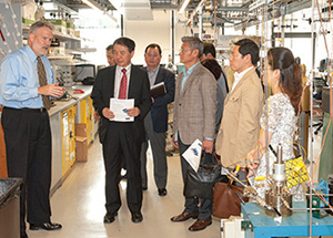 Don Shields (left) leads a Pohang University delegation of academic and industry leaders on a tour of the Center for Energy labs in the Swanson School.
