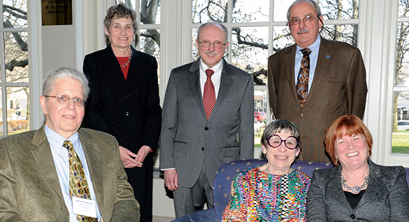 Patricia E. Beeson, Pitt provost and senior vice chancellor, and Alberta Sbragia, vice provost for graduate studies, gather with the four winners of the 2014 Provost's Award for Mentoring. Sitting, from left, are Allan R. Sampson, Marcia Landy, and Provost Beeson. Standing, from left, are Vice Provost Sbragia, Stephen B. Manuck, and Trevor J. Orchard.