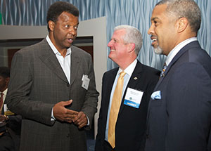 Alumnus Billy Knight (left)—legendary Pitt basketball player, former NBA star, and past executive vice president and general manager of the Atlanta Hawks—converses with Pitt Athletics Director Steve Pederson (center) and alumnus Adam Walker, a former Pitt Panther tailback who went on to play with the NFL's San Francisco 49ers and Philadelphia Eagles.