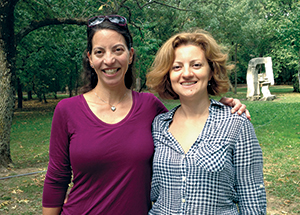Sara Goodkind, left, meets with Raluca Filipache in Buzua, Romania, in 2015. Filipache, now a high school English teacher, participated in Goodkind's first camp for female leadership.