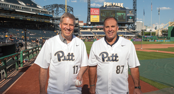 Chancellor Patrick Gallagher (left) threw out the ceremonial first pitch at the July 27 Pirates–Seattle Mariners game at PNC Park. His catcher was none other than Pitt head football coach Pat Narduzzi. Many alumni and their families attended the event, which is sponsored annually by the Pitt Alumni Association. The evening featured a bit of serendipity: beautiful weather, an incredible city view, and an impressive 10-1 Pirates victory. And as the duo posed together for photos, the numbers on their jerseys gave a nod to the University's founding date of 1787. (Photo by Mike Drazdzinski)