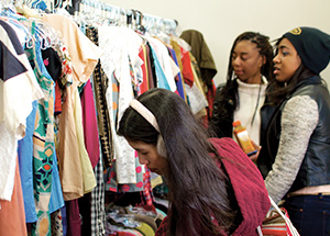 Shoppers peruse clothing in Thriftsburgh. (Photo by Emily O'Donnell)