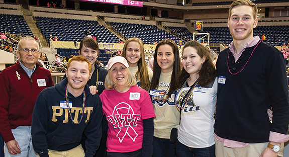 Members of Pitt's Student Alumni Association and the Pitt Alumni Association gathered at the Petersen Events Center on Jan. 24 for dinner in a courtside suite during a Pitt women's basketball game. The event was part of the Student Alumni Association's Dinner with 12 Panthers program, an annual mentoring initiative that pairs students with alumni who host meals and other events. This year, more than 40 alumni hosted 22 events for Student Alumni Association members, including home-cooked meals at alumni homes and lunches at Downtown restaurants. Alumnus Dave Lower organized the lunch at the Petersen. In front row, from left, are Dustin Herbert and Maureen McBride. In back row, from left, are Richard Kowal (A&S '74, GSPIA '76), Kerry Iles, Courtney Bruch, Amanda Monaco, Remi Nuddle, and Greg Kunis.