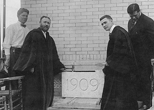 Chancellor Samuel McCormick (second from left) helps lay the cornerstone for Thaw Hall in 1909.  Inset: Time capsule box from 1910 in Pennsylvania Hall