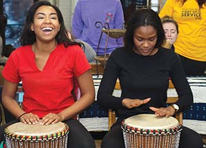 The day was not all work—after a morning of cleaning at Sankofa Village of Arts in Wilkinsburg, participants received the unexpected gift of lessons in African drumming and martial arts.