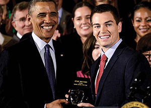 Sean McComb (center) at a White House ceremony honoring him for his Teacher of the Year Award.