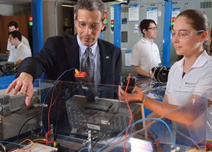 Gregory Reed, a Pitt professor of electrical and computer engineering, with students in Benedum Hall's Electric Power Systems Lab.