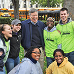 Chancellor Nordenberg jokes with a group of students during Pitt Make a Difference Day in 2011.
