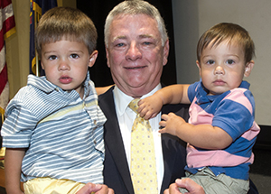 Stephen R. Tritch holds his grandsons, from left, Jack and Will Duncan