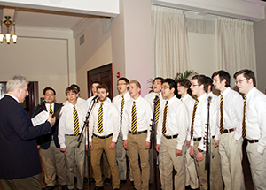 Music Director Richard Teaster (left) and members of the Pitt Men's Glee Club perform during a recent reception for Chancellor Patrick Gallagher in Alumni Hall (Photo by Emily O'Donnell)