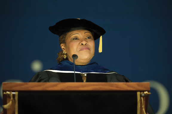 Pitt Dean of Students Kathy Humphrey address students during Aug. 22 Freshman Convocation in the Petersen Events Center.