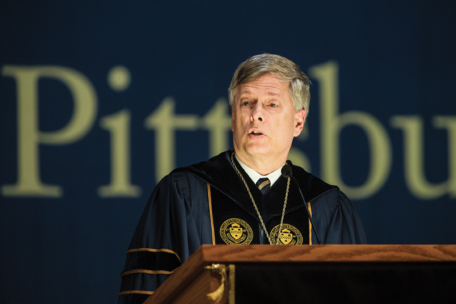 Pitt Chancellor Mark A. Nordenberg address students during Aug. 22 Freshman Convocation in the Petersen Events Center.