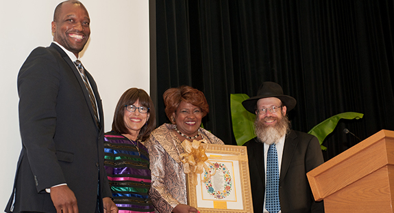 Chabad House on Campus honored Kathy Humphrey, Pitt senior vice chancellor for engagement and chief of staff, with its University Partners Award during a Sept. 1 gala at the O'Hara Student Center. Chabad House, established in 1988 by directors Rabbi Shmuel Weinstein and Sara Weinstein, is a Jewish organization that serves Pittsburgh-area college students and provides social, educational, and cultural programming. From left, Kenyon Bonner, Pitt interim vice provost and dean of students; Sara Weinstein; Kathy Humphrey; and Rabbi Shmuel Weinstein. Photo by Emily O'Donnell.