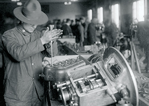 A soldier grinds valves, one of more than 200 distinct skills required to build a Liberty Truck.