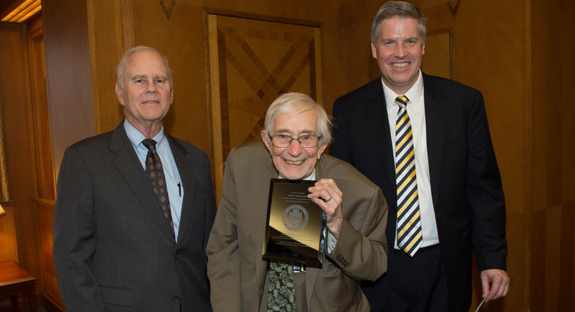 George A. Huber, Pitt vice provost for research conduct and compliance, with Jerome M. Rosenberg (center) and Chancellor Patrick Gallagher. Rosenberg retired from Pitt after 63 years of service.