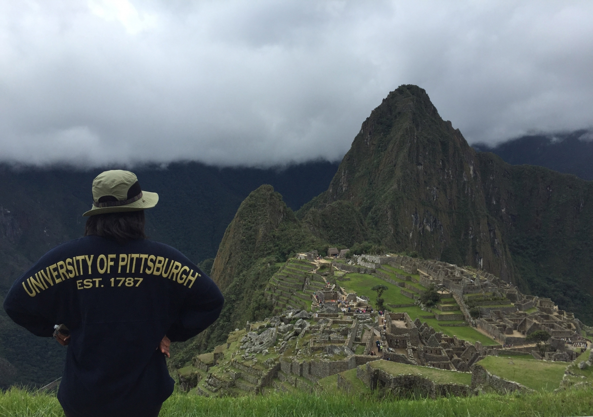 student overlooking a vista in Peru