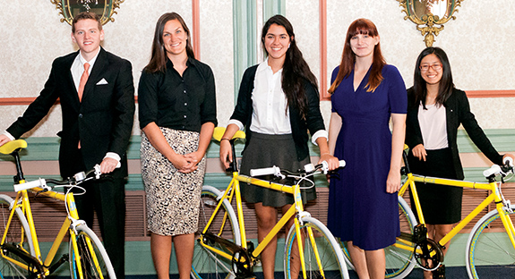 "Members of the ""Project Towers"" team—Nicholas Hufnagel, Nuria Marquez, Bailey Lien, and Ken Arble—received bicycles as part of their award for winning Pitt's 2014 Sustainable Solutions Competition. From left are, Hufnagel; Misti McKeehen, director, Office of PittServes; Marquez; Kacy McGill, Student Government Board Environmental Committee chair; and Lien. Not pictured are student Ken Arble (and his new bike)."