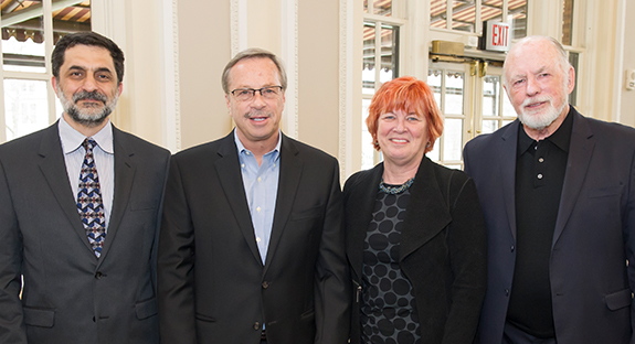 Recipients of the 2017 Provost's Award for Excellence in Mentoring who attended the ceremony posed with Pitt Provost Patricia E. Beeson. From left: Peter Brusilovsky, John Prescott, Beeson and William Dunn.