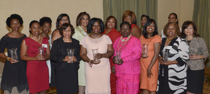 The 2013 New Pittsburgh Courier Women of Excellence are, in front row from left, Esa Matius Davis (wearing red dress), Donna Micheaux, Francine Cameron, Renee Smith Clark, Monica Lamar, and Imogene Hines. In the back row, from left, are Kilolo Luckett (wearing black dress), Staycee R. Pearl, Arnetta Kelly McCormick, Erroline Williams, Anita B. Walker, Ebony Pugh, Monique McIntosh, Charlotte Brown, and Carol A. Neyland. Not pictured is Lutitia A. Clipper.