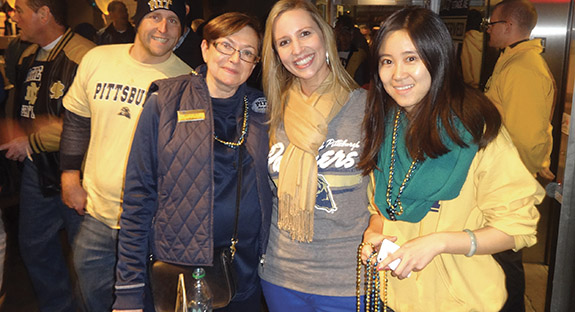 From left, Mimi Koral, director of alumni communications, Pitt Alumni Association; Kara Petro, director, Young Alumni and Student Programs, Office of Alumni Relations; and Yahui Lin, a graduate student in Pitt's School of Education.
