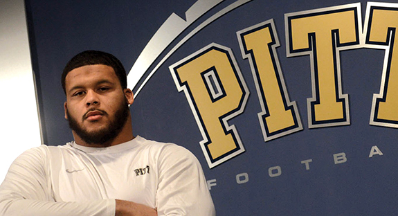 "ALL-AMERICAN AARON DONALD Aaron Donald, Pitt's All-American senior defensive tackle, became the most decorated defensive player in college football during the 2013 season. His crowning achievement—being voted a unanimous All-American—makes him Pitt's first defensive player to earn unanimous status since legendary defensive end Hugh Green in 1980. Donald also scooped up four other esteemed national awards in December: the Bronko Nagurski Trophy, the Chuck Bednarik Award, the Outland Trophy, and the Rotary Lombardi Award. The 6-foot, 285-pound Donald leads the nation in tackles for loss, while ranking 13th in forced fumbles, and 12th in sacks. ""It is tremendous as a coach when your best player is also your best worker,"" Pitt head football coach Paul Chryst said. ""Aaron truly enjoys the film study and preparation part of the game. He plays every day in practice like it's a game day. Aaron has earned all of the accolades he has received, and we are all incredibly proud of him."""