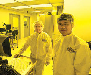 "Hrvoje Petek (left) and Hong Koo Kim, codirectors of Pitt's Petersen Institute for NanoScience and Engineering, are standing in the nanofabrication area of the lab's ""clean room."" The area houses such advanced nanoscale patterning equipment as electron-beam or ion-beam lithography. The process requires an ultraclean environment with a controlled level of air contamination."