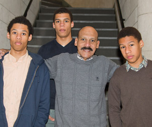 Dean Davis and his sons recently attended Pitt Rep's The Gammage Project at Pitt's Henry Heymann Theatre in the Stephen Foster Memorial. From left are Amani, 17; Naeem, 16; the dean; and Keanu, 14.