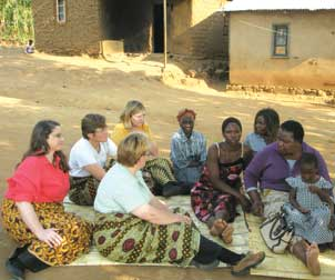 Pitt's Sharon L. Hillier (third from left in yellow shirt) meets with local women and (on Hillier's left) their tribal chief in Blantyre, Malawi, where the Microbicide Trials Network (MTN) operates a site. Hillier is an internationally recognized microbiologist who is the principal investigator for the MTN, an HIV/AIDS clinical trials network established by the National Institute of Allergy and Infectious Diseases. She is also a professor and vice chair for faculty affairs and director of reproductive infectious disease research in the Department of Obstetrics, Gynecology, and Reproductive Sciences in Pitt's School of Medicine. In her role at MTN, Hillier leads an international team of investigators and community and industry partners from seven countries and three continents, directing an ambitious HIV-prevention research agenda.