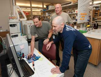 Bruce Freeman (middle, standing), the UPMC Irwin Fridovich Professor and chair of the Department of Pharmacology and Chemical Biology in Pitt's School of Medicine, discovered nitro-fatty acid derivatives that may have applications as a drug to treat diabetes and metabolic and inflammatory diseases. He has launched a pharmaceutical startup company through the Pittsburgh Life Sciences Greenhouse to license the University patents and conduct human clinical trials. From left, Francisco Schopfer, a research assistant professor; Freeman; and Gustavo Bonacci, an instructor in the Department of Pharmacology and Chemical Biology.