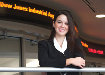 Founder of Trading Pitt, the University's first undergraduate investment club, Cara Repasky stands in front of the business school's state-of-the-art financial laboratory, which was launched in 2008. The $2.3 million, 3,000-square-foot lab provides students with real-time stock market data and access to faculty who are seasoned in global financial markets.