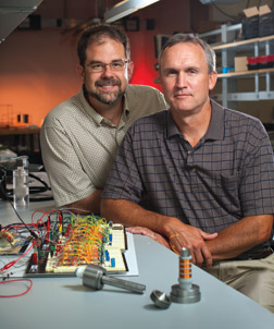 "William ""Buddy"" Clark (right) and Jeff Vipperman, both Pitt professors of mechanical engineering and materials science, were asked by the National Energy Technology Lab (NETL) to develop a valve system for power plant gas turbines that would decrease emissions, control combustion instabilities, and provide fuel flexibility, allowing the turbines to burn conventional fuels such as methane as well as gases derived from coal, hydrogen, petrochemicals, cow manure, and other sources. Clark and Vipperman's research yielded a set of valves that could rapidly adjust fuel flow rate based on information obtained from a combustion sensor developed by NETL, Clark says. The research team now is working with Pitt's Office of Technology Management, along with NETL, to commercialize the innovation."