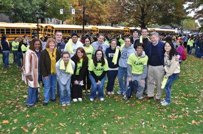 Kathy W. Humphrey (far left), Pitt vice provost and dean of students; Pitt Provost and Senior Vice Chancellor Patricia E. Beeson (beside Humphrey); and Chancellor Nordenberg (far right) pose with student volunteers.