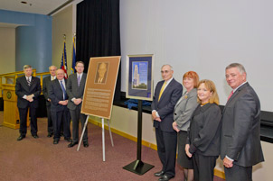 From far left, Chancellor Nordenberg; Trustee Sam Zacharias; N. John Cooper, Pitt's Bettye J. and Ralph E. Bailey Dean of Arts and Sciences; Edward J. Grefenstette, chief investment officer, The Dietrich Charitable Trusts; Richard F. Berdik, CFO, The Dietrich Charitable Trusts; Pitt Provost and Senior Vice Chancellor Patricia E. Beeson; Trustee Eva Tansky Blum; and Board Chair Stephen R. Tritch.