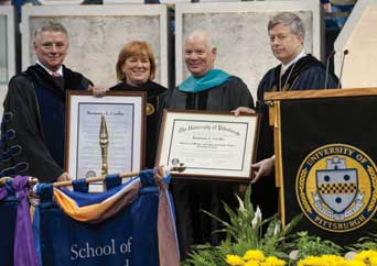 Senator Benjamin L. Cardin received the degree of Doctor of Public and International Affairs Honoris Causa during Pitt's May 1 commencement. From left, Pitt board chair Stephen R. Tritch, Pitt Provost and Senior Vice Chancellor Patricia E. Beeson, Cardin, and Pitt Chancellor Mark A. Nordenberg.