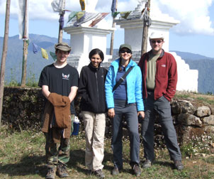 Students from the Swanson School of Engineering teamed up with their counterparts from the Indian Institute of Technology in Kanpur, working in the Indian Himalayas to popularize bamboo as a sustainable construction material. Posing on the road from Rimbik to Darjeeling are (left to right) former Pitt senior Derek Mitch, who graduated in 2009; Bhavna Sharma, civil engineering postdoctoral researcher and recipient of an Integrative Graduate Education and Research Traineeship fellowship from Pitt's Mascaro Center for Sustainable Innovation; civil engineering doctoral student Maria Jaime; and civil engineering professor and William Kepler Whiteford Faculty Fellow Kent Harries.