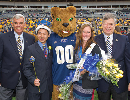 From left, Jack Smith, president of the Pitt Alumni Association; Homecoming King Andrew Kaylor and Homecoming Queen Ainsley Ashton; and Pitt Chancellor Mark A. Nordenberg.