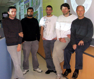 Members of the Pitt team working on the Large Hadron Collider are pictured in the ATLAS experiment control room at the European Organization for Nuclear Research in Geneva, Switzerland. From left, Vakho Tsulaia, graduate student Reza Yoosoofmiya, Thomas Kittelmann, Damien Prieur, and Pitt physics and astronomy professor Joseph Boudreau. Tsulaia, Kittelmann, and Prieur are Pitt postdoctoral researchers.
