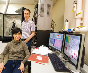 Jeremy Levy, a professor of physics and astronomy in Pitt's School of Arts and Sciences, researches nanosize structures and hopes to advance the basic science that underlies quantum computing. He and Cheng Cen, who recently earned her PhD in Levy's lab, are in front of an atomic-force microscope that is used to create the nanosize structures.
