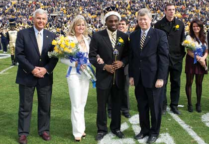 From left, Jack Smith, president of the Pitt Alumni Association; Homecoming Queen Lauren Zammerilla, a senior neuroscience major; Homecoming King Jamil Alhassan, a junior biology major; and Pitt Chancellor Mark A. Nordenberg.
